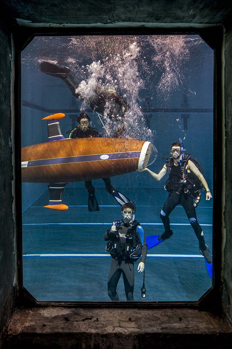 Scuba divers posing in front of the HPS