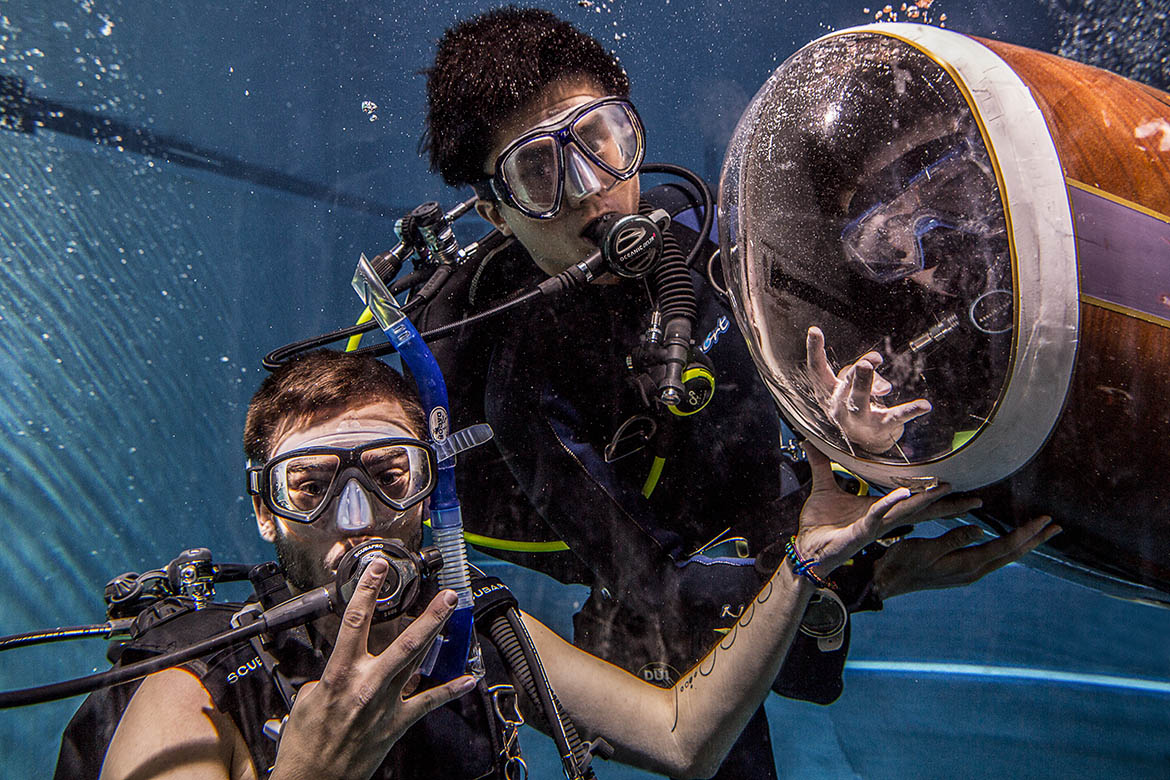 Students posing with HPS under water