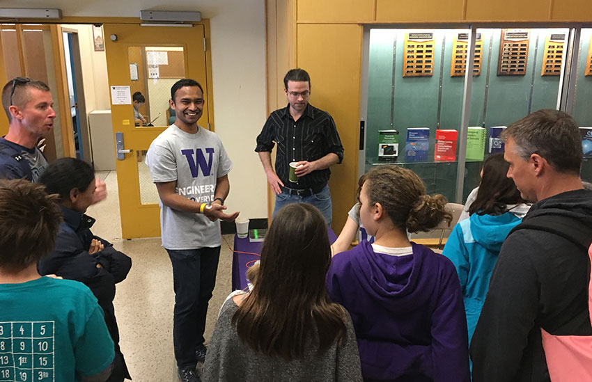 Mukherjee leads a demo at Engineering Discovery Days with ME affiliate assistant professor Eric Rombokas.