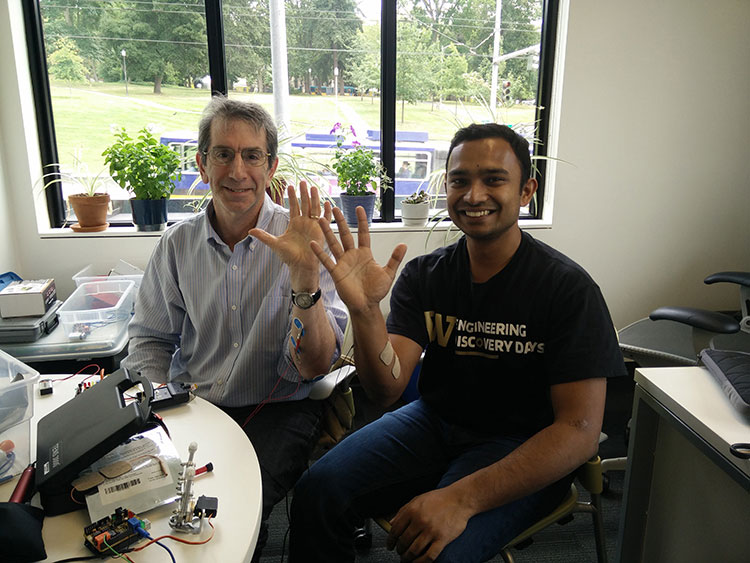 Gaurav Mukherjee sitting with CNT executive director and education director Eric Chudler