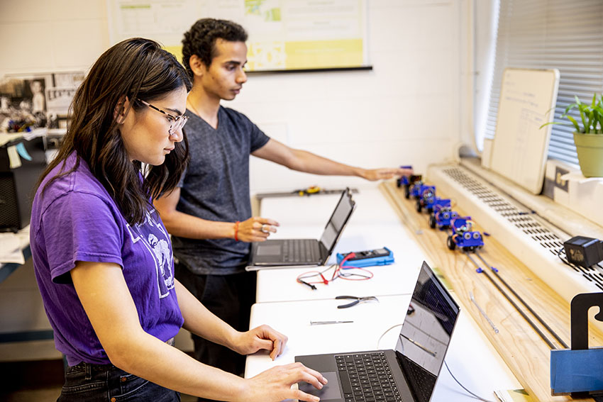 Karli Berger works with ME Ph.D. student Anuj Tiwari on an autonomous vehicles and robotic systems control project