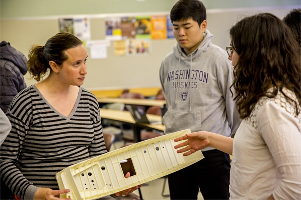 ME alumna Elizabeth Benson shows a wing box model to students