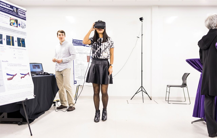 A student demos an AR/VR headset.