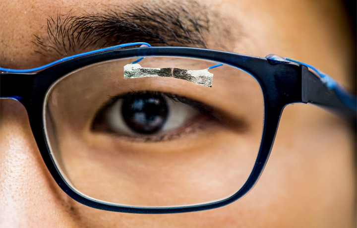 University of Washington graduate student, Jinyuan Zhang, demonstrates how wearable sensors can track eye movement.Dennis R. Wise/University of Washington