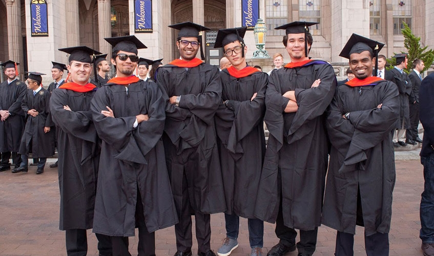 Graduates of ME's master's program wear orange hoods at the department's annual graduation ceremony.