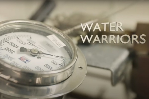 "Image of a pressure guage and the title text ""water warriors"""