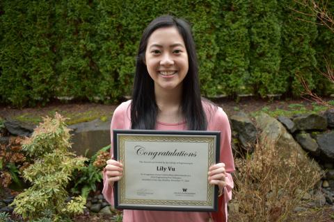 ME junior Lily Vu holding her 2020 Outstanding Engineering Peer Educator Award certificate